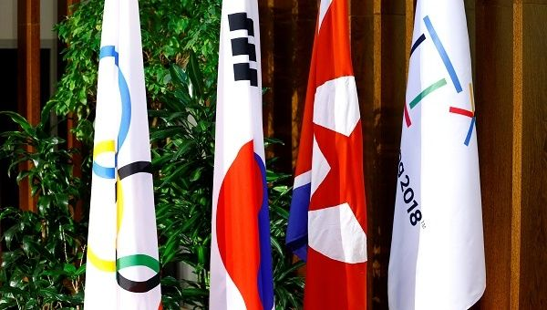Flags of the International Olympic Committee, the Republic of Korea, the Democratic People