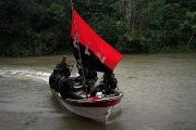 Rebels of Colombia's Marxist National Liberation Army (ELN) arrive in a boat, in the northwestern jungles, Colombia.