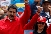 Venezuelan President Nicolas Maduro (L) and his wife Cilia Flores (R).