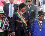 Bolivia's President Evo Morales accompanied by deputies attends a ceremony that marks the 12th anniversary of the Plurinational state in La Paz.