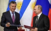 Russian President Putin and his Argentinian counterpart Macri attend a signing ceremony in Moscow