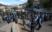 Security forces face off with demonstrators protesting the re-election of Hernandez in Tegucigalpa, Honduras January 23, 2018.