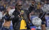 Music artist Snoop Dogg performs during halftime in the NFC Wild Card playoff football game between Atlanta Falcons and Los Angeles Rams.