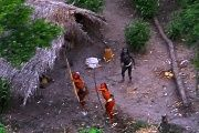 Members of an uncontacted Amazon Basin tribe and their dwellings are seen in the Brazilian state of Acre along the border with Peru in 2008.