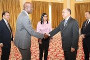 Trinidad and Tobago's Prime Minister Dr. Keith Rowley, second from left, greets Minister of Petroleum and PDVSA President, Manuel Quevedo, and President of the National Constituent Assembly, Delcy Rodriguez.
