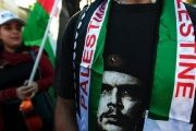 Che Guevara's face is seen alongside Palestine flags at a solidarity rally in Nicaragua.