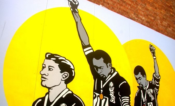 Mural of the raised fist salute of Tommie Smith and John Carlos at the 1968 Olympics.