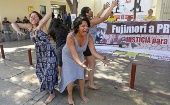 Protesters perform outside a court hearing arguments on former Peruvian President Alberto Fujimori