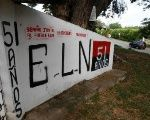 A graffiti, of rebel group Army Liberation National (ELN) is seen at the entrance of the cemetery of El Palo, Cauca, Colombia.
