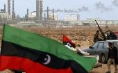Pro-Western rebel fighters outside an oil refinery early in the Libyan coup.