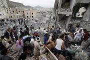 People search under rubble of a house destroyed by a Saudi-led air strike in Sanaa, Yemen August 25, 2017.