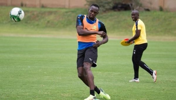 Bolt in a soccer training session in South Africa.