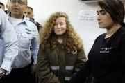 Palestinian teen Ahed Tamimi enters a military courtroom escorted by Israeli security personnel at Ofer Prison, near the West Bank city of Ramallah, Jan. 15.