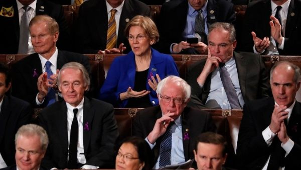 U.S. Senators, including Elizabeth Warren, Tim Kaine, Ed Markey and Bernie Sanders, listen to U.S. President Trump