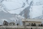 Afghan security forces take position on a roof of a building the site of a blast and gunfire between Taliban and Afghan forces in PD 6 in Kabul.