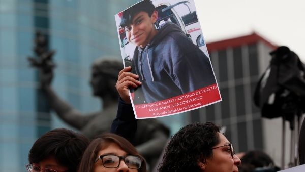 A demonstrator holds up a poster with a picture of high school student Marco Antonio Sanchez, found in bad shape after being disappeared by Mexican police officers. January 28, 2018.