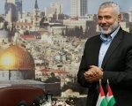 Hamas leader Ismail Haniyeh gestures before delivering a speech in Gaza City.