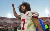 Colin Kaepernick pumps his fist as he acknowledges the cheers at Los Angeles Memorial Coliseum in Los Angeles, California, U.S. on Dec. 24, 2016.