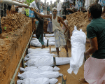 Rohingya refugees, who died after their boat capsized as they were fleeing from Myanmar, are buried in a mass grave just behind Inani beach near Cox's Bazar, Bangladesh September 29, 2017.