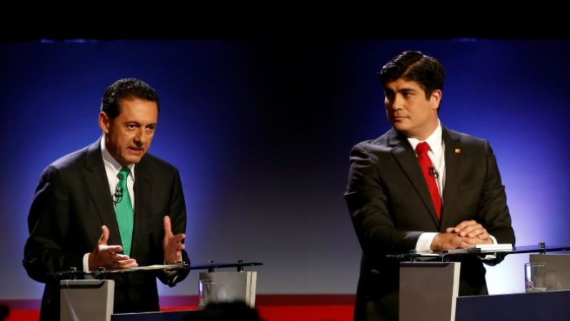 Antonio Alvarez Desanti, of the National Liberation Party, (PLN), speaks next to Carlos Alvarado, of the ruling Citizens