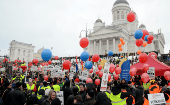 People demonstrate against unemployment benefit cuts in Helsinki.