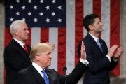 President Trump gestures at the podium in front of Vice President Mike Pence and Speaker of the House Paul Ryan.