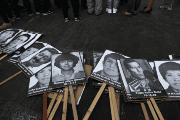 Photos of the victims of the guerrilla conflict which raged during the 1980s and 1990s are displayed at a protest against Fujimori's pardon in Lima, Peru.