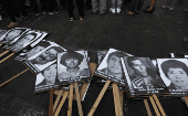 Photos of the victims of the guerrilla conflict which raged during the 1980s and 1990s are displayed at a protest against Fujimori
