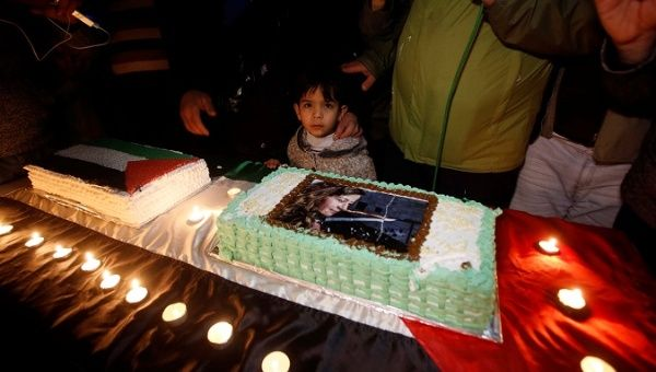 Palestinians take part in a symbolic birthday party for Palestinian teen Ahed Tamimi, who is detained by Israel, in the West Bank city of Hebron Jan. 30, 2018.