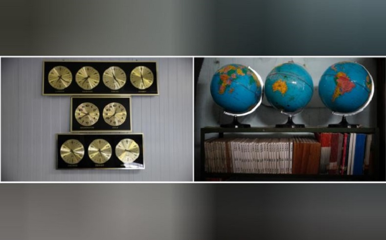 Clocks keep time, measuring the hour of various capitals around the world along the wall of the naval base. Outdated books and well-worn globes line the shelves of a local school in Guantanamo Bay.