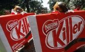Greenpeace activists protest to demand Nestle drops Indonesian palm oil producer Sinar Mas Group.