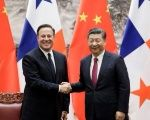 Panama's President Juan Carlos Varela (L) shakes hands with China's President Xi Jinping during a signing ceremony in Beijing, China.