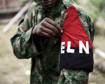 ELN members demonstrates his ELN flag in the northwestern jungles, Colombia August 31, 2017
