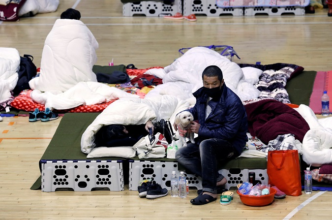 Quake survivors spend the night in impromptu rescue shelter located in a gym in Hualien