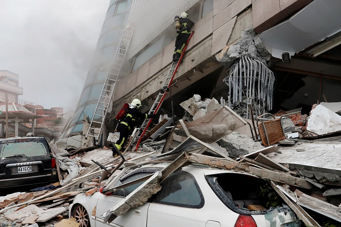 Fallen debris from a damaged building lies on a car in Hualien. More than 100 people were killed in a Taiwan quake in 2016,