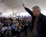 Andres Manuel Lopez Obrador, leader of the National Regeneration Movement party, waves after giving a speech to supporters in Tlapanoloya, Mexico.