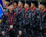 Philippine President Rodrigo Duterte, wearing a military uniform, reviews scout ranger troops upon his arrival during the 67th founding anniversary of the First Scout Ranger regiment in San Miguel town, Bulacan province, north of Manila, Philippines November 24, 2017.