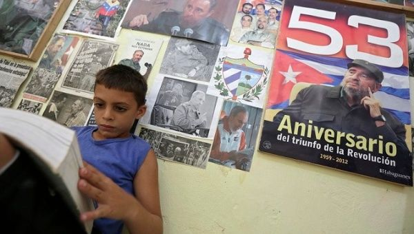 Marlon Mendez, an admirer of Fidel Castro, reads a book in his bedroom in San Antonio de los Banos, Cuba.