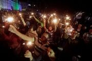 Demonstrators hold torches during a demonstration against the re-election of Honduras' President Juan Orlando Hernandez in Tegucigalpa, Honduras, Feb. 3, 2018.