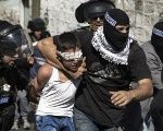 Israeli police detain a Palestinian child in Jerusalem following clashes in the holy city in late Oct. 2014.