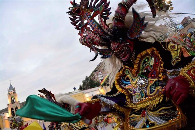 The Diablada is a traditional Bolivian dance that gets its name from the masks and costumes used by the dancer. The dance shows devotion to the Virgen del Socavon (Sinkhole Virgin) and honors the cult to the Uncle of the mine.