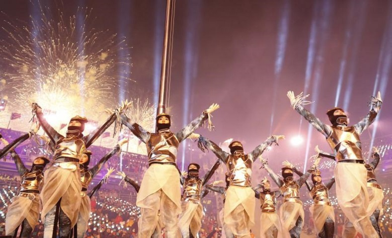 Performers dressed in traditional costume danced for the thousands of spectators attending the opening ceremony.