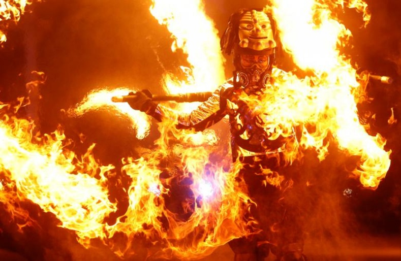A Korean artist aflame in the spirit of Asiatic pride performs an incendiary artistic piece for the Olympic games.