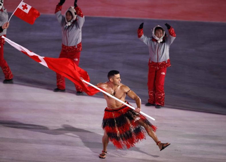 Tongan skier Pita Taufatofua caught international attention by representing his island in traditional clothing - or rather, lack of clothing - and carrying the national flag.