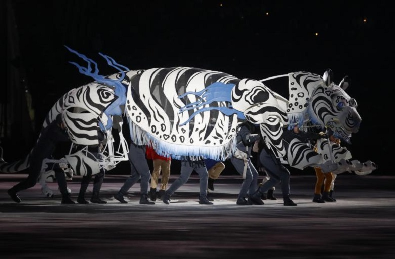 South Korea added an Asian twist to their customary parades prior to beginning the international sporting event.