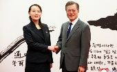 South Korean President Moon Jae-in shakes hands with Kim Yo Jong, the sister of North Korea