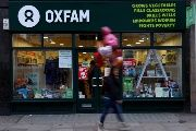 A pedestrian walks past a branch of Oxfam, in London, Britain February 12, 2018.