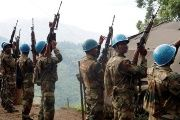 Indian soldiers, serving in the U.N. peacekeeping mission in Congo (MONUSCO), hold up their weapons at their base after patrolling the villages in Masisi