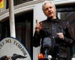 WikiLeaks founder Julian Assange speaks from a balcony outside of the Ecuadorean Embassy in London.