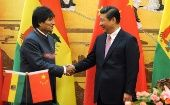 Bolivian President Evo Morales shakes hands with Chinese President Xi Jinping.
